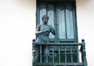 Nude woman on balcony