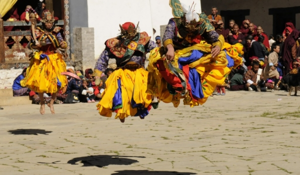 3 monks jumping up