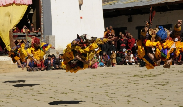 4 monks jumping up
