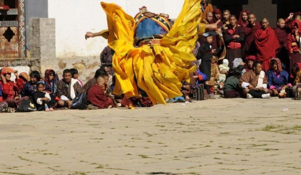 1 monk jumping (back view)