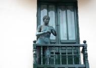 Nude woman on balcony