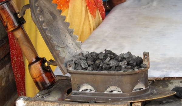 Iron heated by charcoal